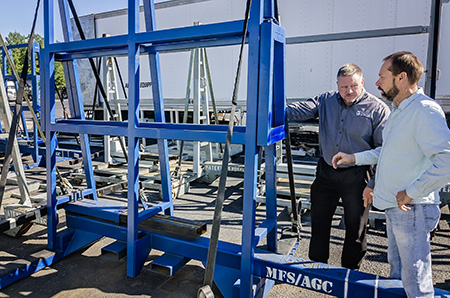 Grant Mize and Jim Toussaint examine a new glass hauling rack at Moore Freight in Mascot Tennessee